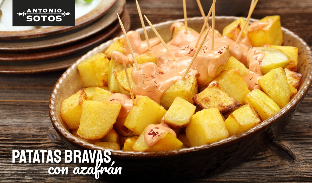 Patatas bravas con alioli de azafrán